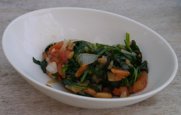 Sauteed spinach with tomato and pinenuts