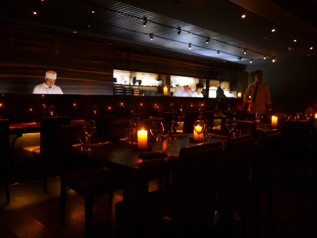 View across to the sushi bar delicately lit by candlelight