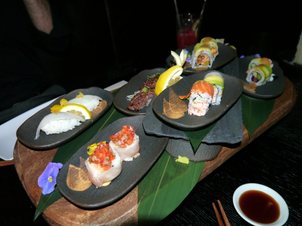 The beautifully decorated platter of maki and sashimi
