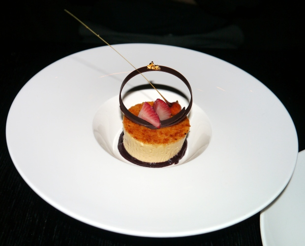Creme brulee with strawberries and chocolate decoration
