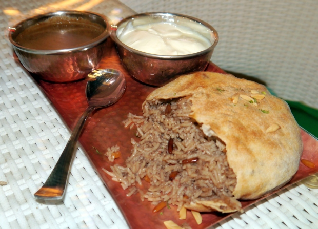 Ouzi - lamb and rice baked in a doughy shell