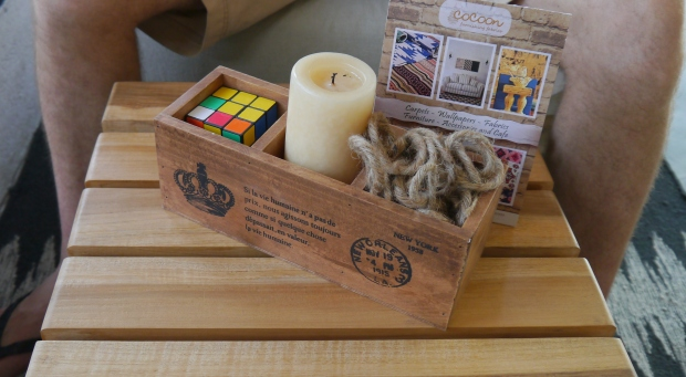 Cute little boxes of rope, a Rubik's cube and candle add a hint of quirkiness