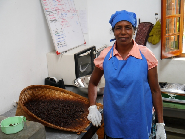 One of the ladies roasting coffee, also grown on the estate