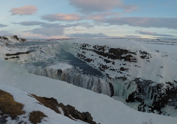 Looking out over Gullfoss waterfall - battling against the freezing cold winds to stay upright!