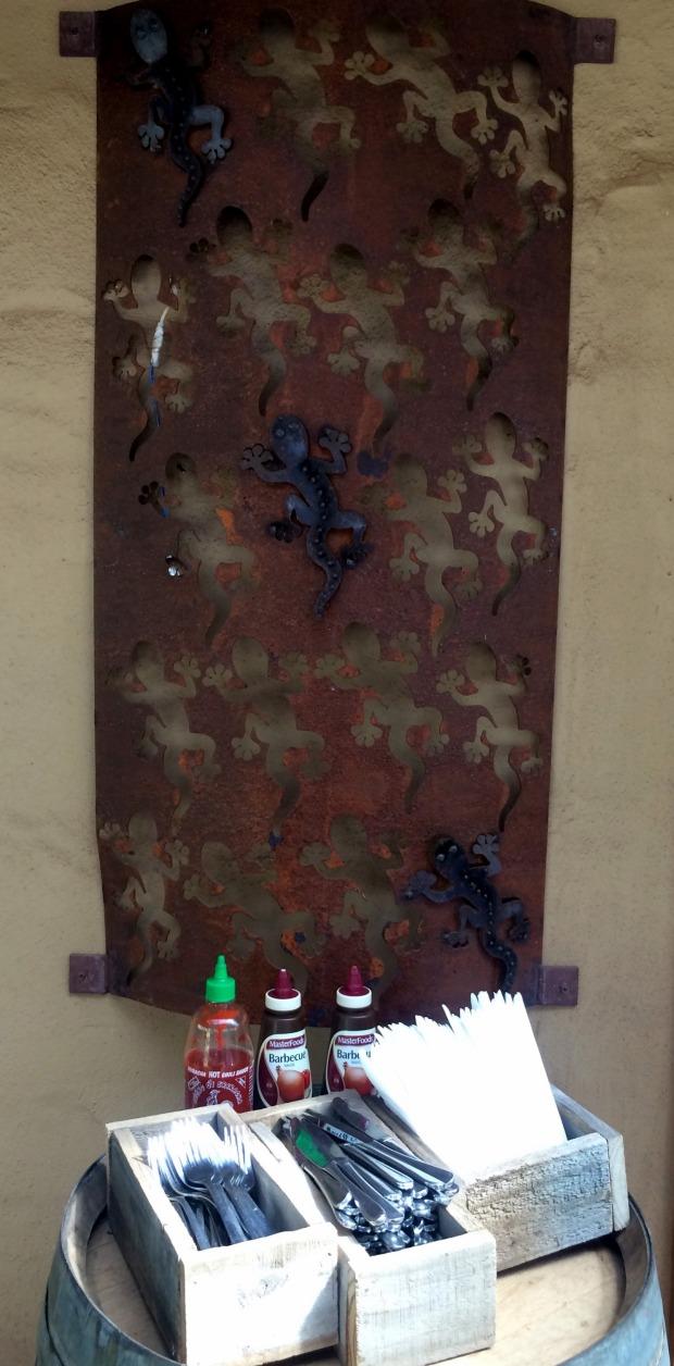 Cut metal work goannas decorate the exteriors